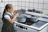 Girl Stirring Soup in Kitchen