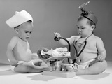 1960s Two Babies Playing Doctor and Nurse with Doll Studio