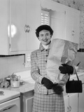 1950s Smiling Woman in Kitchen Holding Grocery Bag Handbag Wearing Hat Gloves