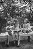 Girls Reading on Park Bench