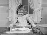 1950s Smiling Girl Rolling Dough in Flour Baking in Kitchen