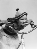 1930s Smiling Eager Little Girl in Knit Cap and Matching Sweater Riding Bike