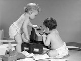 1960s Pair of Babies around Adding Machine with Telephone Off Hook and Papers Scattered on Floor