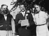 Boy with His Parents on His 8th Grade Graduation  Ca 1940
