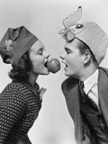 1940s Couple Teen Boy and Girl Wearing Party Hats Bobbing for an Apple on a String