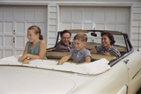 Family Sitting in Car Outside Garage
