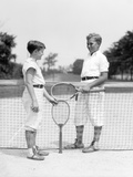 1920s-1930s Two Boys Tennis Match Holding Rackets Measuring Net Height