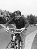 1930s Smiling Boy Riding Bicycle