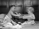 1960s Two Babies Wearing Diapers in Business Office with Adding Machine Playing Accountant