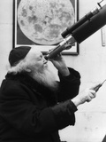 1930s Old Astronomer White Hair and Beard Wearing Skull Cap Looking Through Telescope