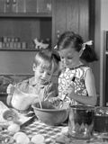 1960s Two Children Boy Girl Bowl Mixing Pouring Milk in Kitchen