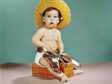 1960s Baby Wearing Cowboy Hat and Holster with Guns Pistols