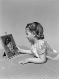 1940s Child Little Girl Looking at Framed Picture of Her Father a Soldier in Uniform