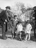 1920s Group of Three Children Watching Organ Grinder's Monkey in Costume Standing on Hind Legs