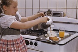 Girl Preparing Breakfast in Kitchen