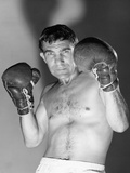 1960s Portrait of Boxer Holding Gloved Hands Up to Protect Face