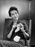 1950s Woman Crocheting Baby Sock