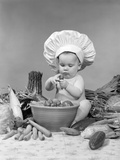1950s-1960s Baby Wearing Chef Hat Toque Bowl and Raw Vegetables Making a Salad
