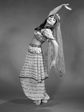 1960s Woman in Belly-Dancer Costume Stretching Back with Arms Out