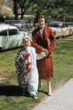 Mother with Son Dressed in Clown Suit Outdoors