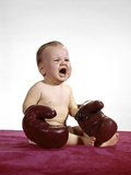 1960s Crying Baby Wearing Large Boxing Gloves