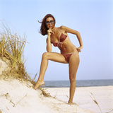 1970s Woman Wearing Two Piece String Bikini Bathing Suit Sunglasses Posing by Grassy Sand Dune