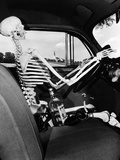 1930s-1940s Still Life of Skeleton Driving Car with Whiskey Bottle and Woman's Shoes on Seat