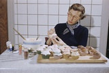 Woman Decorating Cup Cakes