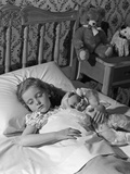 1950s-1960s Little Girl Sleeping in Bed with Arm around a Doll