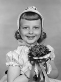 1950s Child Holding Flowers Smiling