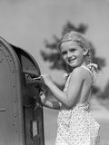 1930s-1940s Child Blond Little Girl with Pigtails Putting Letter into Mail Box