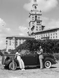 1930s Couple with Golf Clubs Standing by a Car in Front of the Biltmore Hotel Miami Florida