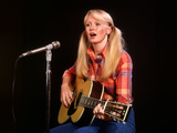 1970s Blond Young Woman Playing Guitar and Singing