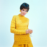 1960s Brunette Woman Short Pixie Hair Style Yellow Knit Sweater Earrings Holding Wine Glass