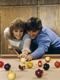 1980s Teen Couple Playing Pool