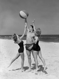 1950s Teens Jumping for Beach Ball Wearing Swim Suits