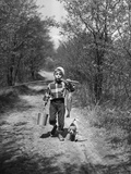 1950s Boy Beagle Puppy Walking Down Country Road Whistling Carrying Fishing Pole Pail Fish