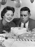 1950s-1960s Couple with Birthday Anniversary Cake Man Blowing Out Candle