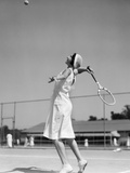 1930s Woman Playing Tennis About to Hit Ball with Racket