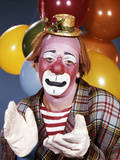 1960s Portrait of Clown with a Sad Expression Wearing Tiny Hat Clapping His Hands
