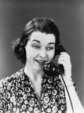 1940s Woman Sunflower Print Dress Talking on Telephone Smiling