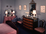 1930s-1940s Bedroom with Blue Walls Pink Bedspread and Skirted Vanity Table