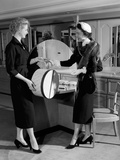 1950s Woman in Hat Stole and Gloves Taking Hatbox from Saleswoman