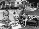 1960s Family in Backyard at Poolside  Father Barbecuing and Mother and Children Making Preparations