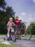 1960s-1970s Two Boys Riding Bikes in Park Summer