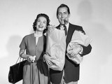 1950s Couple Smiling Woman Man Carrying Grocery Bags Smoking Cigar
