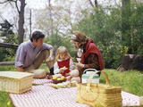 Family Mother Father Girl Spring Picnic on Checkered Tablecloth