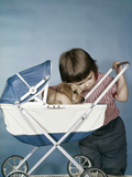 1950s-1960s Little Girl Hugging Cocker Spaniel Puppy Riding in a Baby Carriage Studio