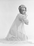 1960s Profile Portrait of Blond Woman in Sheer Nightgown Kneeling Down with Hands Pressed Together