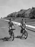 1950s Teen Boy Girl Riding Bikes Suburban Neighborhood Street